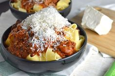 Lamb Ragù - Greek style braised lamb with a hint of cinnamon served over pappardelle pasta and topped with freshly grated mizithra cheese.