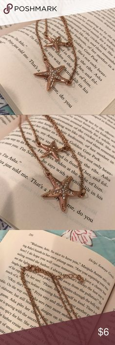 """Rose gold tone starfish double necklace New never worn!  Double starfish necklace, larger one has crystals.  Measures 16-18"""" with an extender.  Costume jewelry not real gold. Jewelry Necklaces"""