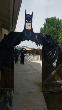 Batman entrance..  Used cardboard and garbage bags held up with PVC pipes..Batman Party Decorations!
