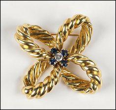 A 14 Karat Yellow Gold, Sapphire, and Diamond Brooch