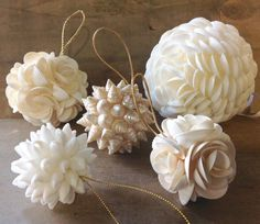 "Seashell Bulb Ornament Seashells handmade into this gorgeous shell flower ball.  All Natural white shells.  A Beautiful Ornament to treasure. Small Size -between 1-2"" inches Large 3"" round   Hand made with seashells Each Ornament we make will vary due to the natural variations of the process.  Handmade in Ventura, Cali"