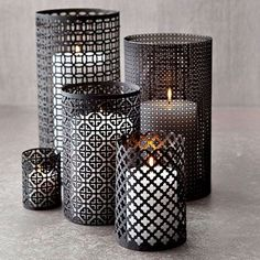 DIY Aluminum Candleholders - made from sheets of decorative mesh aluminum cut into strips. Wrap around containers, (like a soup can) to figure out the size you want.  Secure by twisting wire through the mesh at the top, middle and bottom of the seams. Turn edges of wire inside and spray paint with black primer two times.