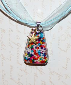 Candy sprinkle resin pendant accented with mini gold star charm