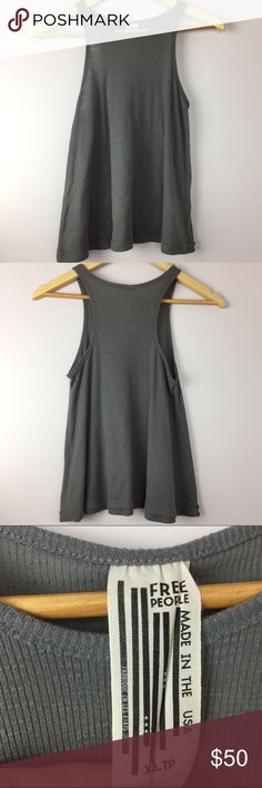 """Free People Long Beach Gray Ribbed Racerback Tank •Free People Gray Racerback Gray Tank •Women's Size XS •Gray Ribbed racerback, fitted upper and loose fitting bottom •In excellent used condition •Made in USA •All measurements are approximate: 21"""" length, 15.5"""" armpit to armpit Free People Tops Tank Tops"""