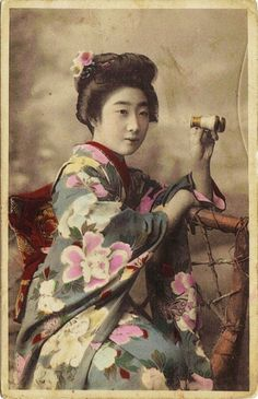 Japanese woman wearing kimono and with opera glasses - Hand colored postcard - Japan - c. 1900Source Flickr Cairlinn