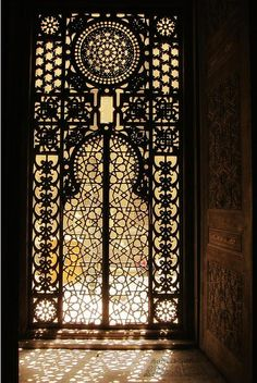 Amazing door in the Royal Mosque, with light shining through the gorgeous complex iron work | Located in Cairo, Egypt