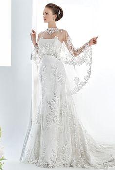 Brides: Demetrios - Ultra Sophisticates. Venice lace, strapless, A-line gown featuring a chapel length train. Lace cape sold separately.