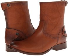 The Frye Melissa Button Zip Short boot is a perfect piece for your daily get-up. ; Leather upper for a durable long-lasting boot. ; Leather lining for a close to foot feel. ; Outside zipper with a cuff strap for a secure fit. ; Leather insole and outsole. ; Imported.