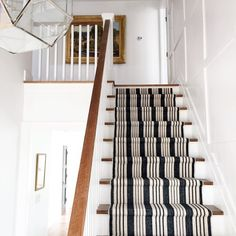 Dash & Albert stair runner, Birmingham Black, Now I want to use a striped runner on my stairs Our farm house has an old stairway. This runner almost looks like ticking with its navy and white stripes. Painted Stairs, Wood Stairs, Basement Stairs, Basement Entrance, Entryway Stairs, Entrance Halls, Basement Ideas, Hallway Carpet Runners, Foyer Decorating