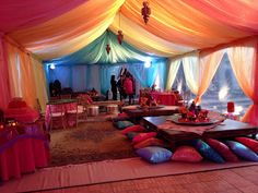Have your guests sit on cushions on the ground for a Moroccan feel!