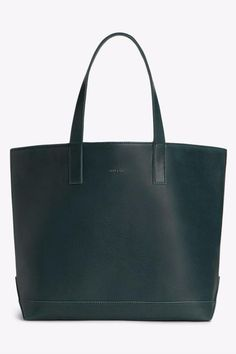"""Tote with magnetic snap closure. Interior: logo-embossed hanging pouch pocket. 100% recycled nylon lining.    Dimensions: 18"""" x 13"""" x 6.5"""" Handle Drop: 8.5""""   Schlepp Tote Amazon by Matt & Nat. Bags - Totes Canada"""