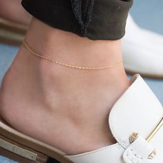 The perfect summer accessory. A dainty diamond cut gold anklet chain. Available at www.loveaudryrose.com