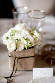 simple and natural white ranunculus table setting bunch with burlap base