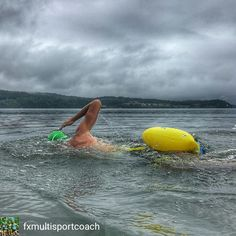 """From @fxmuItisportcoach . . """"Go the extra mile it's never crowded"""" It was pouring rain when we started but @jdelong_83 swam long anyway. 3000 yd OWS: huge gains @newwaveswimbuoy FTW!  #fxfriday #bebrightbeseen #fxmultisportcoaching #triathlontraining"""