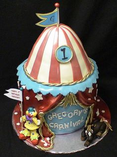 CARNIVAL TENT - THE CLOWN AND THE HORSE ARE MADE FROM GUMPASTE/FONDANT.  THE CAKE WAS AIRBRUSHED RED AND THEN COVERED WITH A HEAVY COAT OF PEARL.  IT KIND OF MADE THE WHOLE CAKE LOOK LIKE A TOY.