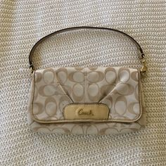 COACH small clutch.  Gold classic pattern. COACH small clutch.  Gold classic pattern.  In good, used condition.  One small stain inside - on the inside flap (as seen in the pictures). Offers welcome. Coach Bags Clutches & Wristlets