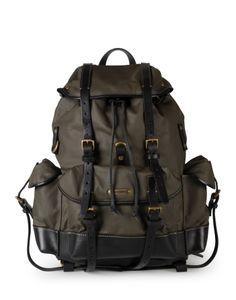 DSQUARED2 CARLOS BACKPACK: Rugged military green wool gabardine trimmed with dark brown leather straps and details make Dsquared2's backpack handsome enough to take on the urban jungle, or for a casual weekend adventure. The construction is classic utilitarian backpack. External pockets make essentials easily accessible, and a laptop and a change of clothes fit effortlessly in the main bag.