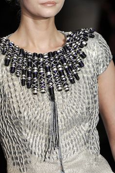 Armani Prive - very original design on this bodice which is rich in textural detail. Reminiscent perhaps of tribal jewelry?