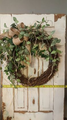 Handmade item  Materials: grapevine wreath, glue, wire, wired burlap, realistic fern, realistic greenery  Made to order Ships from United States  Questions? Contact shop owner Item details This beautiful burlap greenery wreath is the perfect simple accent for your door or interior. A wired burlap ribbon makes a simple bow. Average Diameter: 22 (tip to tip) This wreath will be created on a grapevine wreath measuring approximately 18 Indoor/ Sheltered Outdoor Safe  **avoid exposing this wreath…
