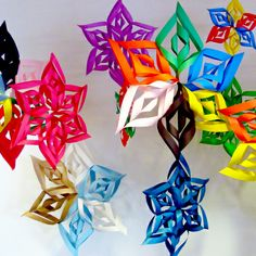3D Snowflakes  My 9 yr old daughter came home from school with one of these, so we made a bunch to hang from the ceiling.  Way cute... Especially the ones made from paper with two different sides (like one side white and the other side red).