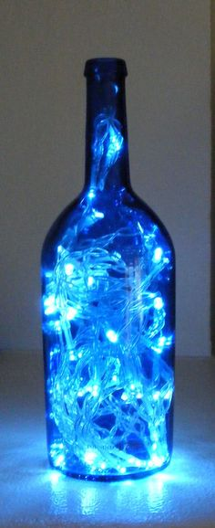 LED Lamp Out of a Wine Bottle Blue: bottle. iv made 1 of these with coloured lights and hand painted the outside of a wine bottle it looks lovely Neon Licht, Everything Is Blue, Cool Lamps, Blue Bottle, Blue Glass Bottles, Painted Bottles, Wine Glass, Paint Wine Bottles, Bottle Bottle