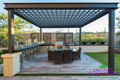 Modern Landscape/Yard with Trellis, Outdoor kitchen, Fence, Raised beds, exterior tile floors