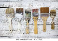 Old used brush set in art studio - stock photo