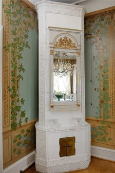 Elegant Fireplace surrounded by trompe-l'oeil treillage painting on the walls in the Dining Room of a Swedish Castle.