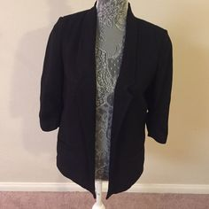 Lauren Conrad blazer  Sleek and classy Lauren Conrad black blazer. Rouching detail on 3/4 length sleeves. Stays open in front. Beautiful and classy. Two faux pockets-- one on each side in front.  Dry clean only. Lauren Conrad Jackets & Coats Blazers