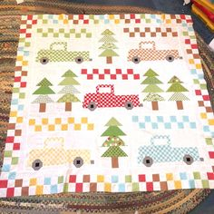 I made the original of this pattern Vintage Christmas from @ericaarndt over a year ago. At the time I had this idea to make the trucks vintage colors. I changed up the sashing measurements, added some 2-1/2 blocks and I am delighted with the finished top. Sew Cherry Two from @beelori1 and some Bee Basics were the perfect fabrics. The background is from @kimberbelldesigns basics. It's perfect because it's cherries. Kits will be available soon @regalfabricsandgifts You can order Erica's… Lap Quilts, Quilt Blocks, Quilt Baby, Moose Quilt, Tree Quilt Pattern, Modern Quilting Designs, Christmas Quilt Patterns, Winter Quilts, Quilted Wall Hangings