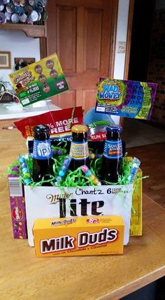 I made 6 Pack Beer Holder Easter Baskets for my older Kids! They turned out adorable! Contain beer, candy, peanuts, sunflower seeds and scratch offs! Very easy! Candy boxes taped to side of box & back row tore the bottle dividers to add nuts, seeds & big egg full of chocolate.