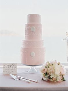 Wedding Cake with Vintage Cameo Motif. Dinner, catered by the club, included a choice of filet mignon or halibut.��The design of the cake, by Beaux G�teaux, complemented the vintage cameo motif.
