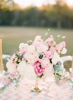 Romance reigns with this pastel pink peony centerpiece. While this is technically a bridal bouquet, it's got that balance of formal and casual that would work perfectly in a simple glass vase on a tablecloth covered picnic table. Gold Wedding Colors, Pink And Gold Wedding, Wedding Color Schemes, Floral Wedding, Wedding Flowers, Trendy Wedding, Summer Wedding, Peonies Centerpiece, Floral Centerpieces