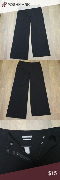 Black slacks wide leg. Good condition, hem Black slacks wide legged,  good condition, lightly worn.  Hem on right leg needs resewn,  easy fix. Apt. 9 Pants Wide Leg