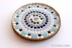 Add a little vintage flair to your space with this fun mosaic lazy susan with a blue heart tile design.