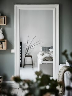 I like the vibe of this home. The green-grey walls combined with the white hard wood flooring give the home a very fresh look and the furniture and accessories are chosen very carefully to create a stylish, cozy place with character. Bedroom Decor, Grey Walls, Rustic Bedroom Decor, Bedroom Organization Diy, Room Decor Bedroom, Apartment Bedroom Decor, Home, Decor Design, Interior