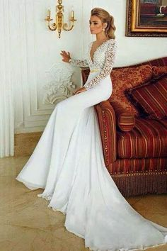 DREAM DRESS. Long sleeves, deep neck, fitted long silhoette. Detailed lace and beading with simple bottem