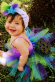 Leighton in her peacock tutu! I absolutely love the way it turned out! And I'm glad I found this little purple swimsuit in her closet!!!!!