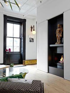modern black fireplace   photo laura moss