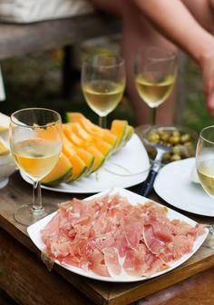 Prosciutto, melon, and chilled California white wine
