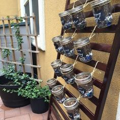 When my son outgrew his crib, I took the side of the crib off and used it as a stand for my vertical herb garden. I used mason jars and chalkboard stickers and some hemp string to tie it to the crib. Mason Jar Garden, Mason Jars, Chalkboard Stickers, Herb Garden, Hemp, Crib, Gardening, Gardens, Crib Bedding
