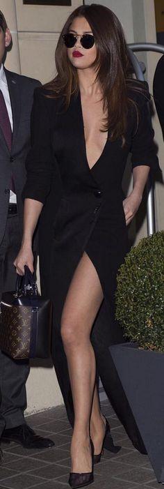Selena Gomez: Coat/dress- Ronald Van Der Kemp  Sunglasses – Dior  Purse – Louis Vuitton  Shoes – Soebedar