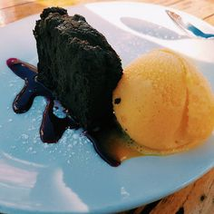Just enjoyed this lovely chocolate cake made of pure Belgium chocolate and some orange sorbet. #food #instagood #chocolate #love #ice
