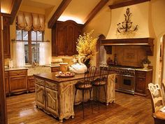 French Country.  I love this style.  I wish I could do my entire house like this.  Now that's a pretty island!