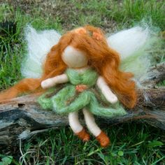 Needle felted World Fairy Waldorf inspired  By Rebecca Varon pinks and she has dark skin and brwon hair with blues