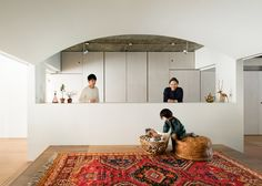 Japanese architect Masatoshi Hirai has refurbished an apartment in Tokyo, creating one shared bedroom, living space and wardrobe for its inhabitants.