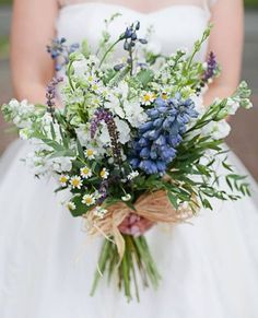 White, blue & purple wild flower bouquet. Hyacinths, blue bells and snapdragons are all awesome, unconventional wild flower choices that come in vivid colours.