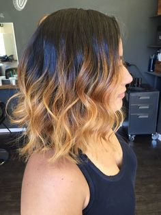 Warm caramel ombre with a mid length bob haircut. Styled with beach wave curls.