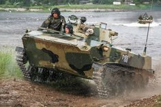 Russian Airborne Troops equipped with BMD-2 armored vehicles during drills in the Pskov region on July 5, 2017