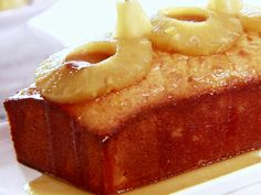 Pineapple Pound Cake from FoodNetwork.com but I might add coconut milk instead of pineapple juice and not use cake mix. but make a pineapple syrup for the top... can't tell if it will work or not.. worth a try though.
